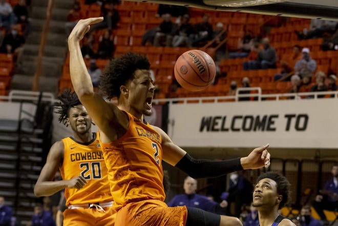 Oklahoma State guard Cade Cunningham celebrates a slam dunk during Wednesday night's loss to TCU. It was the Cowboys' Big 12 opener.