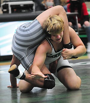 West Branch's Kenny Marra wrestles Canton South's Tyler Williams in the 220-pound class of an Eastern Buckeye Conference match at the West Branch Field House Thursday, December 17, 2020.