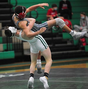 West Branch's Alex Cortney, white singlet, is a district qualifier for the Warriors at 120 pounds.