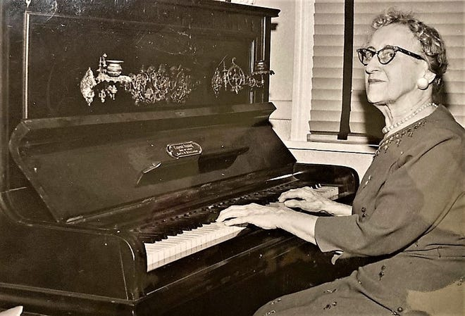 Dorothy Hines at the keyboard of her piano, spent half a century as a celebrated and often honored Augusta educator and civic leader. A Richmond County school is named for her.