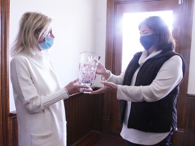 Glascock County Commission Chairman Lori Boyen (at right) presents a gift to Judge Denise Dallas (at left) during a retirement ceremony Wednesday, Dec. 9. Dallas has served Glascock County in a variety of positions. She retires from her posts as Probate/Magistrate Judge and Election Superintendent.