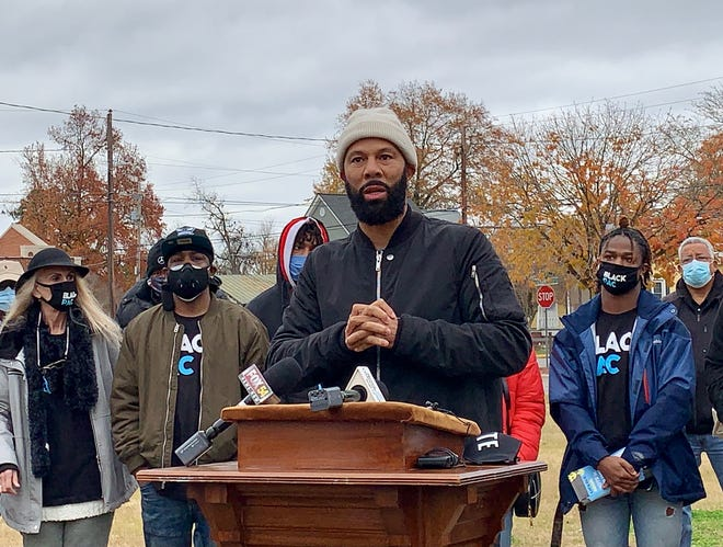 Award-winning artist Common, center, calls for all Georgians to come together and vote in this Senate runoff outside Bethel AME Church in Augusta Thursday, Dec. 17 before heading out to do door-to-door voter canvassing in Augusta.