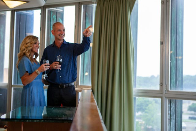 Jim and Patty Thompson of Bartlesville enjoy the views at Price Tower from one of the suites overlooking Unity Square.
