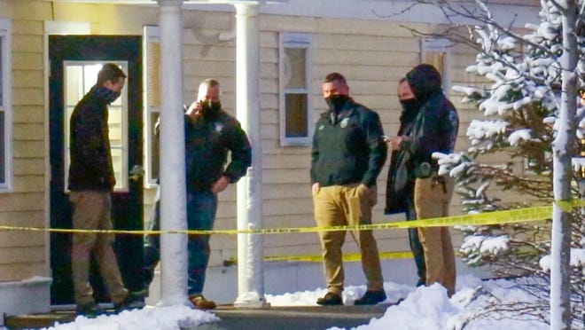 The scene at an apartment on Wampanoag Drive in Mashpee, where police say an unresponsive woman was found Friday morning. Her son has been charged in her killing.