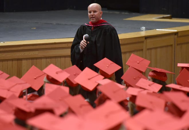 Barnstable High School Principal Pat Clark speaks during the Class of 2019 graduation ceremony. Barnstable School Superintendent Meg Mayo-Brown told parents and guardians Friday that he has resigned.