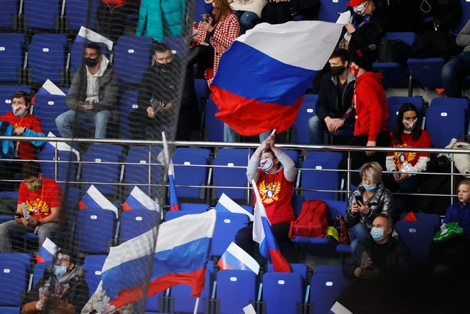 Russian spectators support their team during the Channel One Cup ice hockey game between Sweden and Russia in Moscow on Thursday.