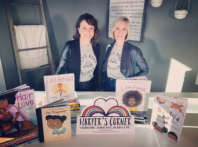 Kat DePizzo, left, vice president of Harper's Corner, and founder Julia Hanna with some of the diverse books the organization donates to central Ohio elementary schools.