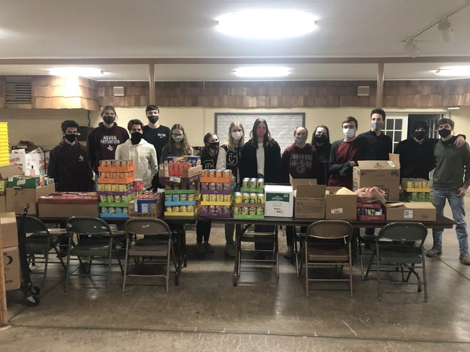 John Glenn High School students collected 1,690 items for the College Drive Presbyterian Church Food Bank during a food drive at the school in New Concord.