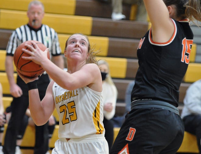 Waynedale's Brooklyn Troyer puts up a shot in the post against Dalton's Tess Denning. Troyer had 30 points in the Golden Bears' win.