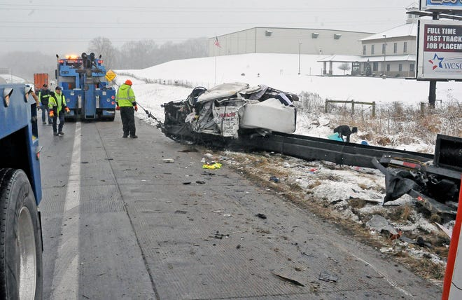 Tow trucks work to remove what is left of a vehicle involved in one of two accidents on U.S. Route 30 just east of Wooster Friday morning.