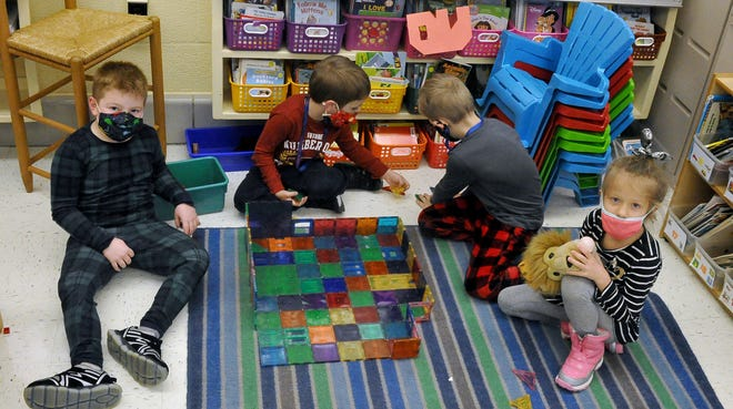 From left, Luke Willard, Kyler Molner, Gunnar Smith and Peyton Baker spend some time building in their kindergarten class on Dec. 17, 2020, when students celebrated pajama day and the last day before winter break.