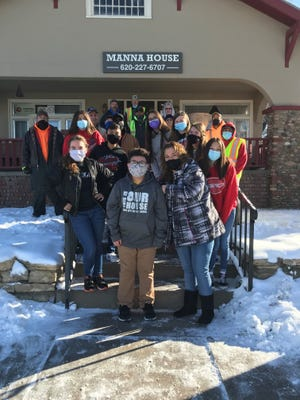 Dodge City Middle School and Comanche Middle School participated in a food drive competition collecting 7,071 items of food for the Manna House of Dodge City. Pictured are DCMS STUCO members, USD 443 maintenance and Manna House volunteers.
