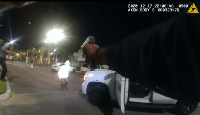 Daytona Beach police shot a man who they said was holding a sharp object and ran at an officer at One Daytona in December. Pictured is a screen grab of the incident taken from police body camera video.