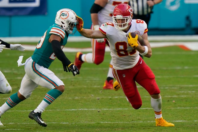 Chiefs All-Pro tight end Travis Kelce stiff-arms Dolphins safety Brandon Jones this past Sunday. Over the last three weeks, Jones has played half of the Dolphins' defensive snaps.