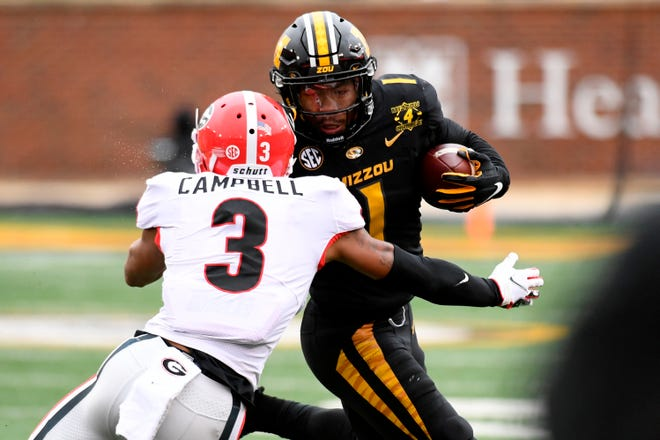 Missouri running back Tyler Badie, right, runs with the ball as Georgia defensive back Tyson Campbell (3) closes in during last Saturday's game in Columbia. The Tigers close out the regular season Saturday at Mississippi State and await their bowl fate on Sunday.