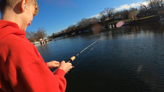 Ellis Morton had a good day fishing for rainbow trout with a borrowed lure.