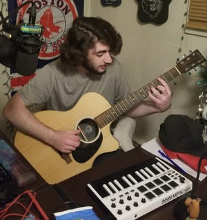 Gavin Rondeau of Somersworth, a sophomore at  Cocheco Academy of the Arts in Dover, seen in his home music space, has been named All-State.