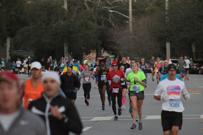 Runners in the Ameris Bank Jacksonville Marathon race along San Jose Boulevard on January 5, 2020. [Clayton Freeman/Florida Times-Union]