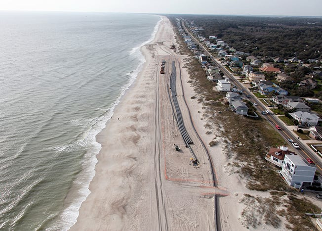 Pipes for moving sand onto Fernandina Beach from dredging will be set up with public crossings like these from an earlier beach replenishment project.