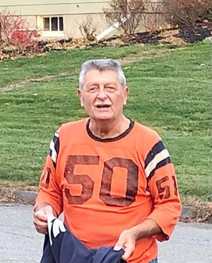 Though it's been 55 years since he wore it for the champions of North Worcester County, Bill Hulette, 72, can still fit into his #50 Gardner High football shirt from 1965.