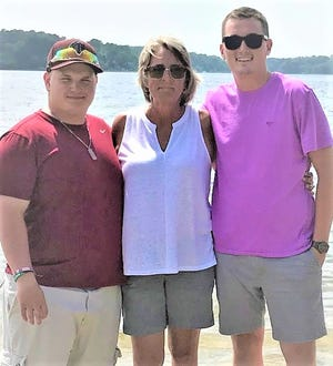 Oakmont Athletic Hall of Famer Maureen Casey, center, coached her sons on their youth sports teams before watching them compete at her alma mater. Liam Gorman, left, played football and ran track, while Shamus Gorman played football, basketball and baseball.