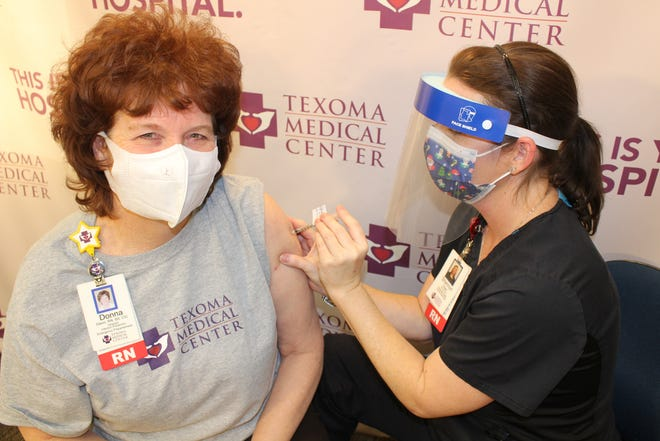 The photo is of Donna Glenn, RN, TMC Director of Infection Prevention and Emergency Preparedness receiving the vaccine on Thursday, December 17, 202  from Shannon Foster, RN, TMC Employee Health Nurse.
