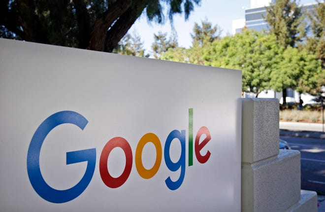 This Oct. 20, 2015 photo shows signage outside Google headquarters in Mountain View, Calif. A group of 35 states as well as the District of Columbia and the territories of Guam and Puerto Rico filed an anti-trust lawsuit against Google on Thursday, alleging that the search giant has an illegal monopoly over the online search market that hurts consumers and advertisers. (AP Photo/Marcio Jose Sanchez, File)