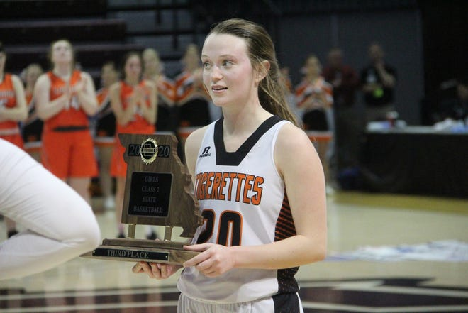Then-Macon senior Katie Richardson holds the team's Class 2 third-place trophy at the Final Four.