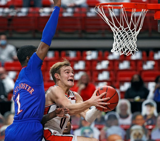 Texas Tech guard Mac McClung knifes past Kyon Grant-Foster to the basket during the Red Raiders' 58-57 loss to No. 5 Kansas in a Big 12 opener Thursday night at United Supermarkets Arena. McClung scored a season-high 21 points.