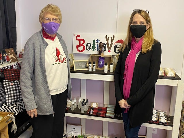 Darlene Luttrell, left and Kassi Compton, right, are selling homemade items in Atlanta, Illinois.