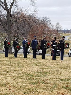 Wreaths are presented in honor of branches of the U.S. military as well as prisoners of war and service members who are missing in action during a recent Wreaths Across America ceremony at the Leavenworth National Cemetery.