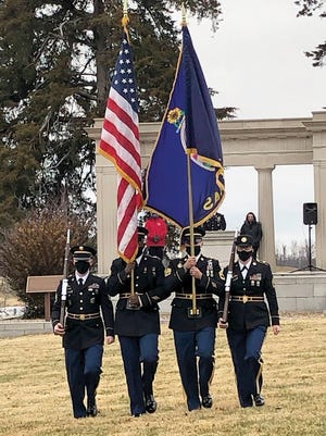 A color guard from Fort Leavenworth participates in a recent Wreaths Across America ceremony at the Leavenworth National Cemetery.