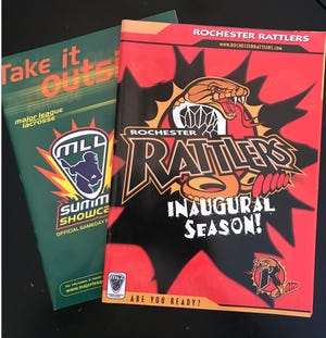 Programs for the MLL's Summer Showcase, left, and the inaugural season for the Rochester Rattlers are keepsake items now that the MLL is no more.