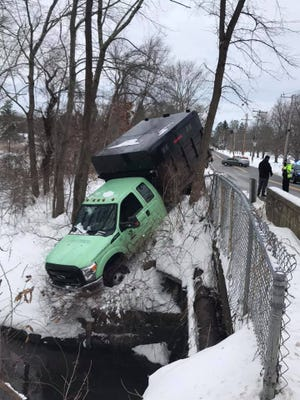 An Ashland police lieutenant pulled a truck driver to safety on Friday, Dec. 18, 2020, after he was trapped in his truck just a few feet from the water.