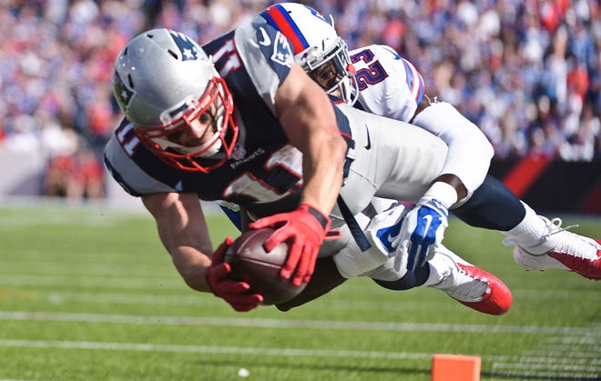 New England Patriots wide receiver Julian Edelman (11) dives past Buffalo Bills free safety Aaron Williams (23) for a touchdown during the second half of an NFL football game Sunday, Sept. 20, 2015, in Orchard Park, N.Y.
