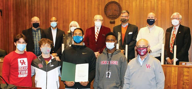 City honors Wildcats — In front are Wildcat football players Cole Adams, from left, Mitchell Gibbons, Jaxon Adams and Jaeden Eleam and coach Joe Gaddis, recently honored by a city proclamation declaring Dec. 14 Oak Ridge High School Wildcats Football Team Day. Behind them are Oak Ridge City Council members Chuck Hope, from left, Derrick Hammond, Ellen Smith, Warren Gooch, Rick Chinn, Jim Dodson and Kelly Callison. 'I've never been more proud of a group of guys and a football team, and I love the way the city united around them,' Gaddis said.