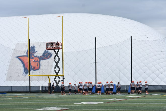 The Utica College football team practices on the turf at Gaetano Stadium during 2019. The school, which also has a dome for indoor activities, is adding another outdoor turf facility adjacent to Gaetano Stadium. The new facility will be able to be used for multiple sports and include a track.