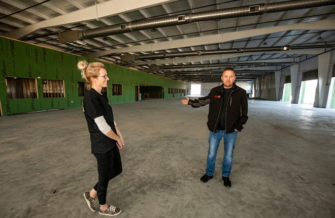 Brittany and Josh Hart talk about the expansion of their business while standing in the new showroom building that will house over 80 cars.