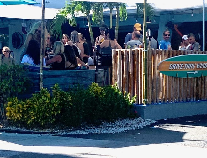 BOCA RATON -- Scenes like this one at Aloha Food Shack last Sunday has local officials concerned about controlling spread of the virus. On Tuesday, Palm Beach County Health Director Alina Alonso implored restaurants to enforce social distancing and for customers only to remove their masks in the act of eating.