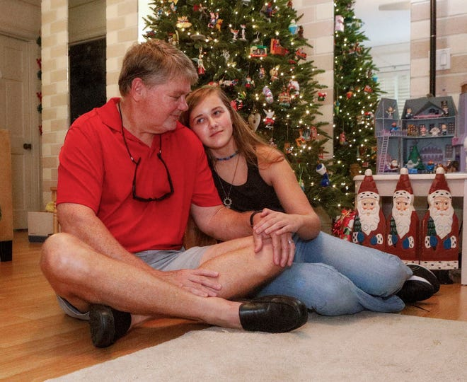 Tom Gregory shares a moment with his daughter Madison, 13, at their Palm Beach Gardens home. The restaurant general manager penned a Christmas poem to his young daughter more than a decade ago. It still rings true today.