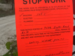 Authorities posted this latest stop-work order on Tuesday, Dec. 15, 2020, to the gate at a lake and building that three water-skiiers have constructed without permits near the Valencia Reserve community west of Boynton Beach.