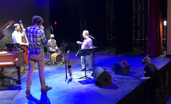 On the right, cameraman Jared Merrill with Advanced Visual Production converses with the John Winn-tet band in the Jimmy Dean Theater at the Perkinson Center for the Arts and Education on Dec. 12, 2020.
