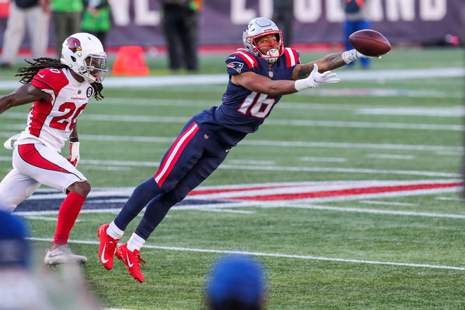 Nov 29, 2020; Foxborough, Massachusetts, USA; New England Patriots receiver Jakobi Meyers (16) reaches for the ball during the first half against the Arizona Cardinals at Gillette Stadium. Mandatory Credit: Paul Rutherford-USA TODAY Sports