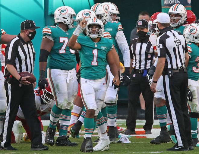 Dolphins quarterback Tua Tagovailoa (1) celebrates after scoring a touchdown against the Chiefs during a game last week. The rookie grew up watching the Patriots during their dynasty years and has a chance to end their playoff hopes on Sunday when the teams play at Miami.
