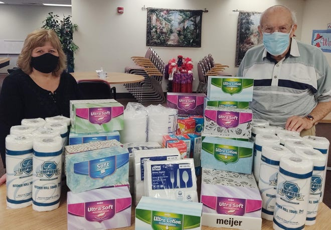 The Brady Lake Women's Group recently donated essention items to the Portage County Senior Center. With some of the items are Theresa Summers, manager of the senior center, and senior Mike Montecalvo.