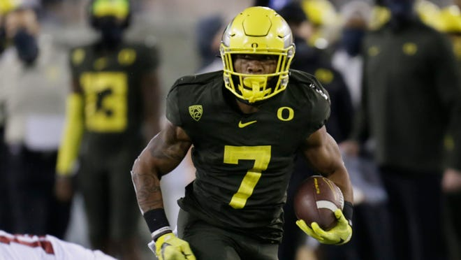 Oregon's CJ Verdell, seen here in the season opener against Stanford, was the Pac-12 championship game MVP last year when he ran for 208 yards and three touchdowns in a 37-15 win over Utah.