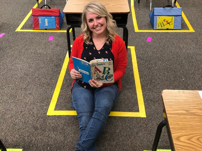 Brooke Herbert, a kindergarten teacher at Beacon Academy in Canton, won a classroom makeover through Wayfair Professional's Dream Classroom Giveaway. She is leaning against one of the new soft reading seats she picked for her classroom.