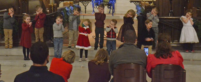 The Christ Cathedral Montessori School afternoon students perform Silent Night during the Christmas concert inside the Christ Cathedral on Thursday evening. The Christ Cathedral Montessori School is a school that started in October and is for 3-6 year olds.