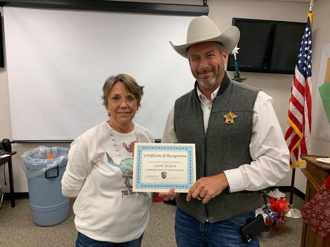 The Erath County Sheriff's office held its annual Christmas party and awards ceremony. Laurie Jackson received Support Staff of the Year and is presented a certificate by Sheriff Matt Coates.