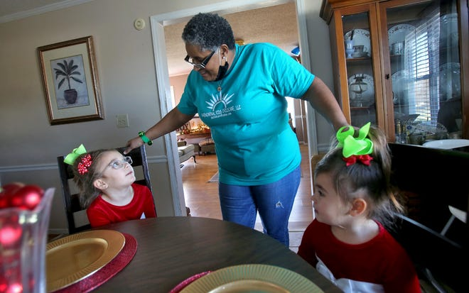 Annette Samuels chats with Lorelei Bridges, 6, and Holland, 3, at Phenomenal Kids Childcare Services.